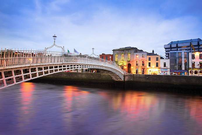 Dublin at dusk: waterfront and historic Halfpenny Bridge