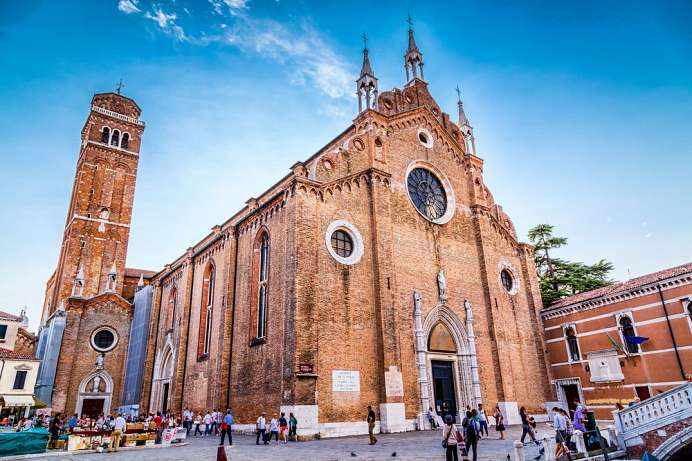 Outside plain and common, inside splendour and wealth: Frari