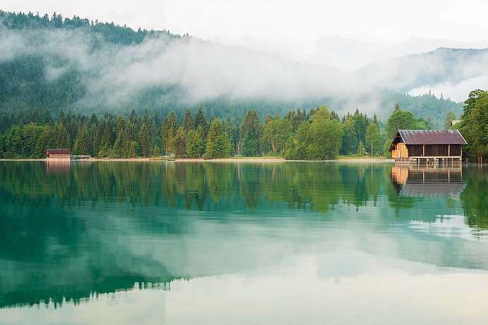 Wafts of mist in the morning over the Walchensee